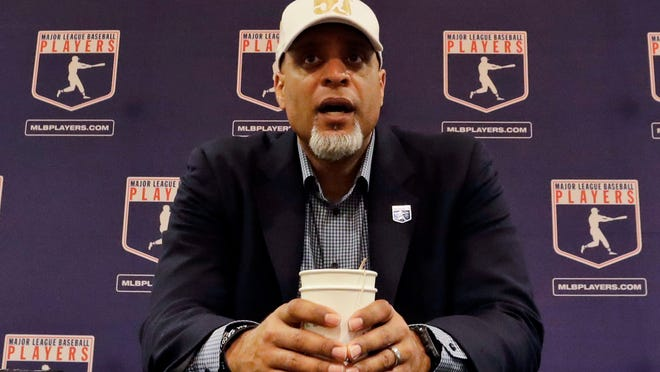 In this Feb. 19, 2017, file photo, Tony Clark, executive director of the Major League Players Association, answers questions at a news conference in Phoenix. Baseball players told the commissioner's office on Saturday night that additional talks to start the season during the coronavirus pandemic are pointless and said owners should order a return to work.