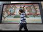 John Bahena of Juarez carries a deer statue to his
