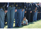 An officer's son plugs his ears during the 21-gun salute