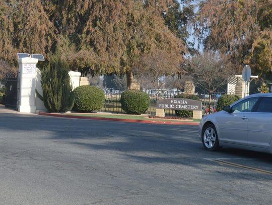 A car drives near the Visalia cemetery's entrance on