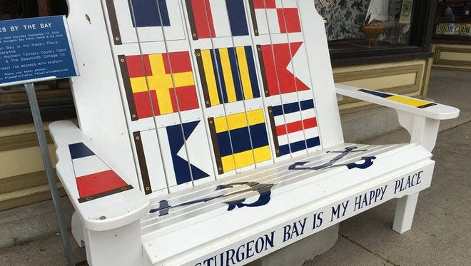 """Sturgeon Bay is My Happy Place"" by Suzi Derenne, one of the artist-decorated benches available to bidders in the Sept. 17 Harvest Festival and Street Art Auction in Sturgeon Bay."