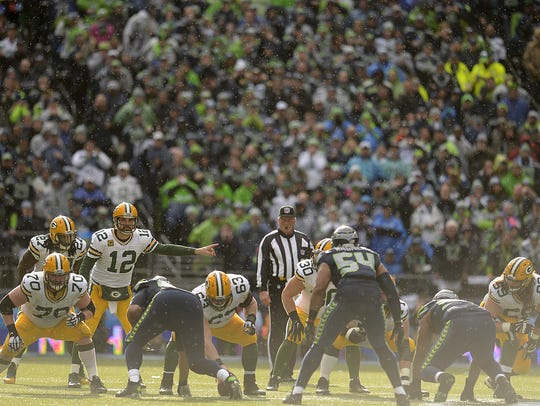 Green Bay Packers quarterback Aaron Rodgers (12) gives