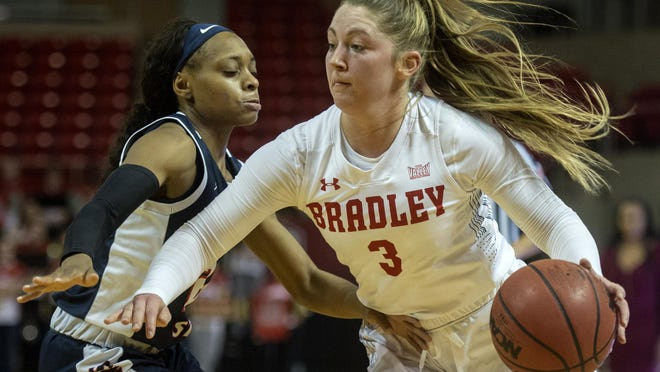 Bradley's Gabi Haack makes a move around a Jackson State defender last season at Renaissance Coliseum. Haack and an experienced BU team began summer workouts this week.