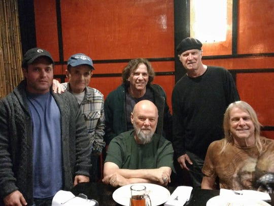 Steve Davidowski, standing far right, joined his one-time
