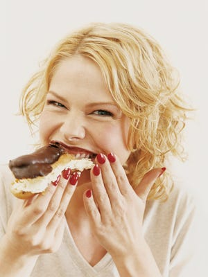 Portrait of a Young Woman Eating a Chocolate Eclair