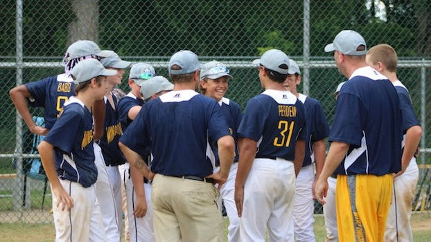 The state championship team gathers on the mound after the game in celebration. Tribune photo by Chapin Jewell