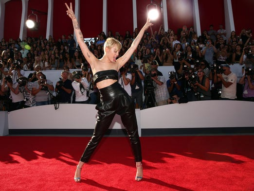 Miley Cyrus arrives for the MTV Video Music Awards on Aug. 24 in Inglewood, Calif.