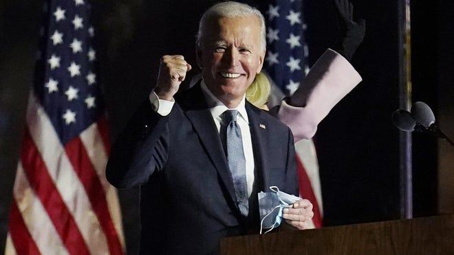 President-elect Joe Biden gestures on stage after speaking, Saturday, Nov. 7, 2020, in Wilmington, Del.