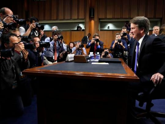 Supreme Court nominee Brett Kavanaugh, right, takes