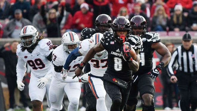 Louisville's Lamar Jackson (8) runs 68 yards for a touchdown against Virginia on Saturday at Papa John's Cardinal Stadium. Nov. 11, 2017