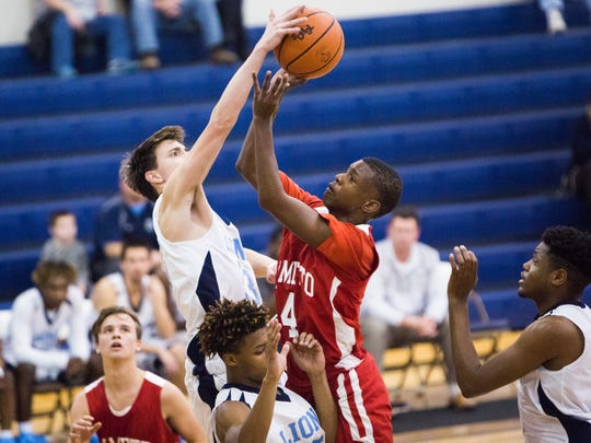 Daniel's Ben Sawyer blocks a shot by Palmetto's Tay Thomason in a game Wednesday in Central.