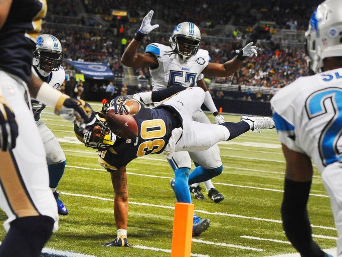 Rams rookie running back Todd Gurley dives for the