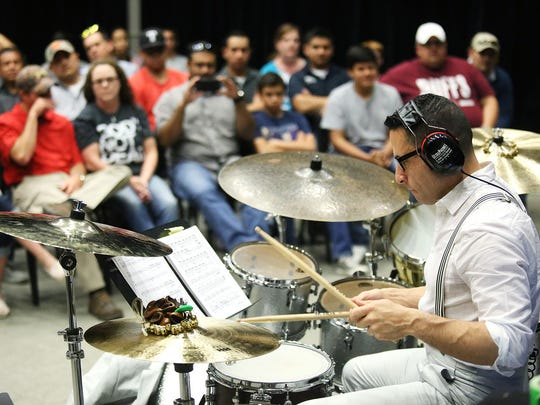 Andres Forero, drummer for the Broadway show 'Hamilton,' performs segments of the show at the Wagner Noel Performing Arts Center in Odessa, Texas.