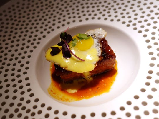 Kimchi bacon with shrimp toast, fried egg, yuzu emulsion