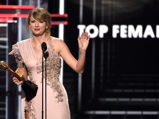 Taylor Swift accepts the award for top female artist