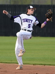Trinity Christian Academy's Tyler Thomas makes a catch at second base during Tuesday night's game against Adamsville.