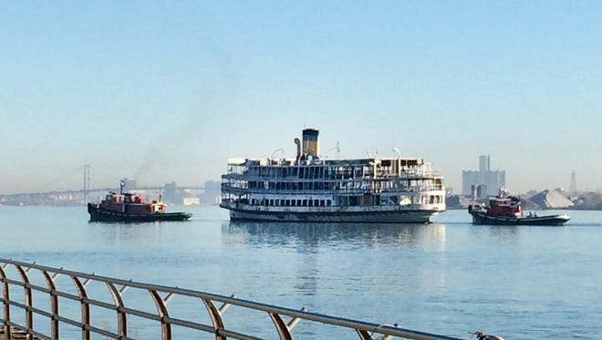 Tugboats pull former Boblo boat SS Ste. Claire on Wednesday, Nov. 4, 2015 up the Detroit River.