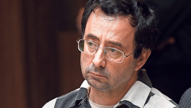 Dr. Larry Nassar listens as a young woman who was a former family friend speaks about alleged abuse by Nassar in court Friday. Later, 55th District Court Judge Donald Allen Jr., ruled there was enough evidence in court February 17, 2017 for Nassar to stand trial on charges of first-degree criminal sexual conduct with a person under 13.