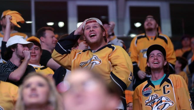 Predators fans cheer for their team during the watch party for game 6 of the playoff series between the Predators and Jets in Walk of Fame Park Monday May 7, 2018.