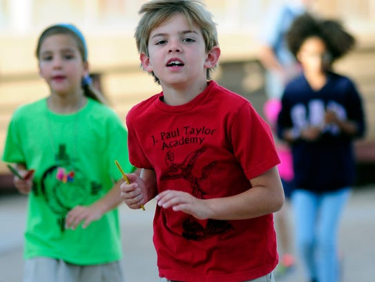 Chase Kaufman, 8, runs with his classmates  J. Paul