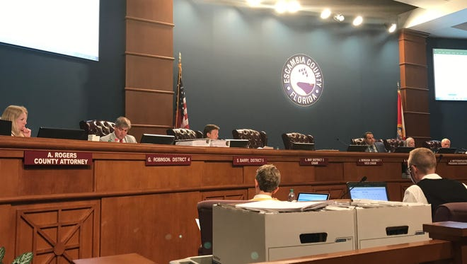 The Escambia County Board of County Commissioners discusses the 2017-2018 fiscal year budget during a workshop July 11, 2017.