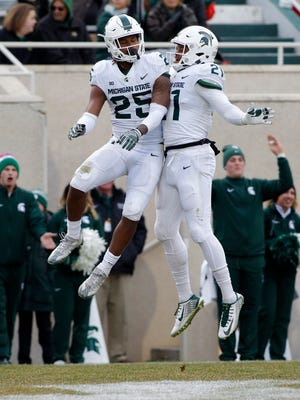 Michigan State receivers Darrell Stewart, left, and Cam Chambers celebrate Stewart's touchdown reception during the first half of an NCAA college football scrimmage Saturday, April 7, 2018, in East Lansing, Mich.