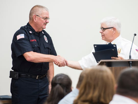 Firefighter James Startzel is awarded the Departmental