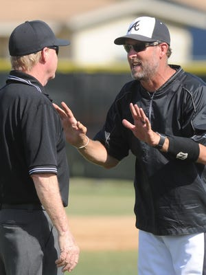 Abilene High coach Ryan Lewis, right, argues a call in the second inning. He wasn't happy that Doak Holloway was called out for interference after colliding with Keller Timber Creek shortstop Mateo Gil on Wes Berry's ground ball.