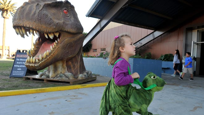 Abigail Nahmias, 3, of Ventura, takes a look around last year's Jurassic Quest.