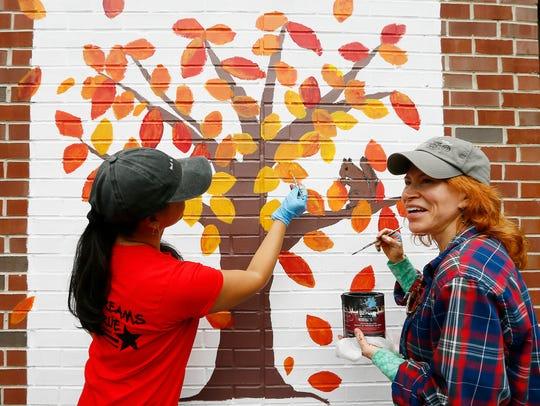 Gilda Lee and Bernadine Ferrari of Kinnelon paint the