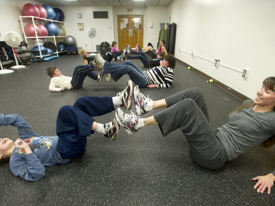 9-year-old Ben Wolf and his mother Melisa  exercise together at the Dover YMCA. DAILY RECORD/SUNDAY NEWS--JASON PLOTKIN