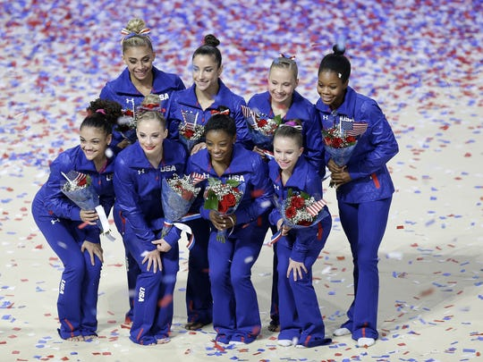 U.S. Olympic women's gymnastics team members Ashton Locklear, clockwise from top left, Aly Raisman, Madison Kocian, Gabrielle Douglas, Ragan Smith, Simone Biles, MyKayla Skinner and Lauren Hernandez pose for photos after competing in the U.S. Olympic gymnastics trials in San Jose, Calif., Sunday, July 10, 2016. (AP Photo/Ben Margot)