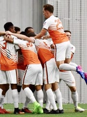 Bucks players celebrate after scoring a goal in Sunday's 2-2 draw against Chicago United FC.