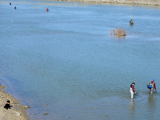 Fishermen braved the cold weather to catch walleye in the Sandusky River near downtown Fremont.