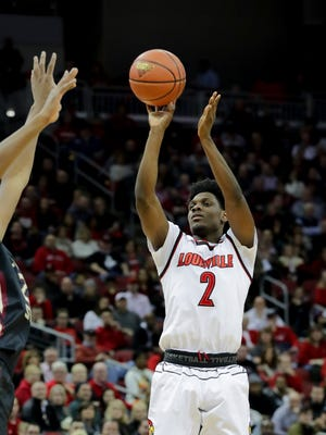 Louisville's Darius Perry knocks down a three against FSU.