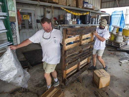 Greg Marshall and Kyle Porter clean up Marshall Marine