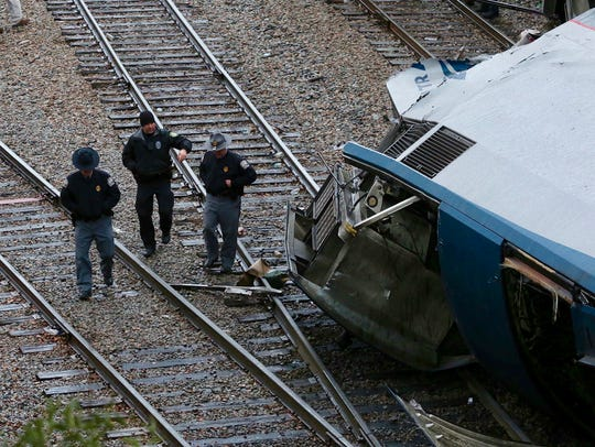 Authorities investigate the scene of a fatal Amtrak