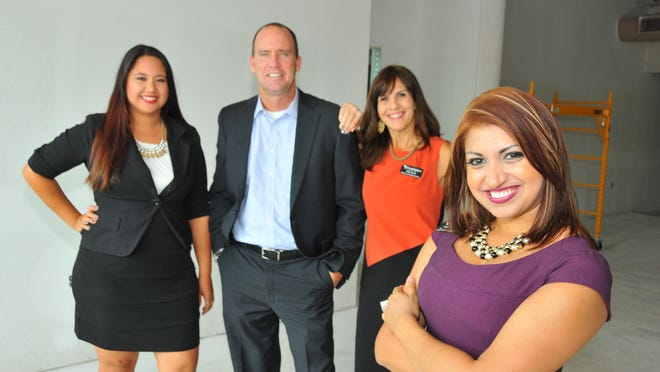 Candlelighters of Brevard is getting excited about its new offices and thrift store opening on Fifth Avenue in Indialantic. Left to right: Vanessa Steele, office administrator; Brendan McCarthy, board president; Adis Perez, director of family services and Natasha Duran, executive director.
