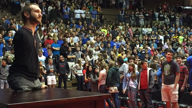 Nick Vujicic of Life Without Limbs looks over the crowd after he invited students to stand up to demonstrate their commitment to fight bullying at their schools.