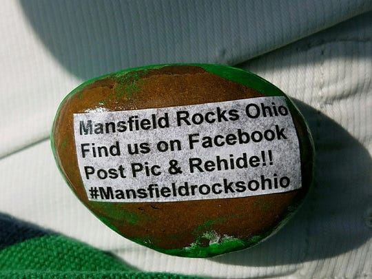 Labels on the underside of painted rocks tell people what to do with the rock once they find it. Hiders keep an eye out to see how far their rock travels.
