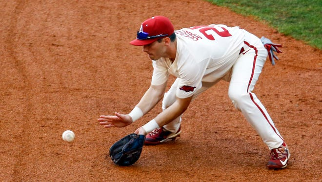 Arkansas second baseman Carson Shaddy fields a ground ball before throwing to first for an out against LSU's Daniel Cabrera during the Southeastern Conference tournament Saturday in Hoover, Ala.