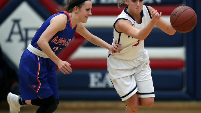 Appleton East's Aubrey Roberts, right, steals a pass intended for Appleton West's Julia Smith during Friday's game at Appleton East.