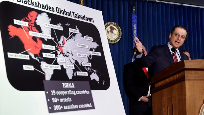 File photo taken in 2014 shows Preet Bharara, U.S. Attorney for the Southern District of New York, at a news conference about  arrests in the Blackshades malware investigation.