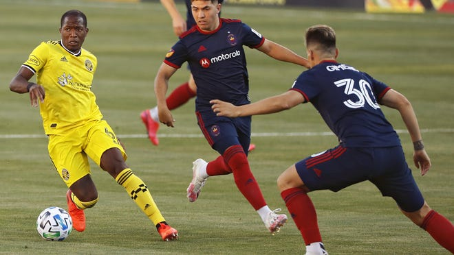 Darlington Nagbe tries to elude the Fire's Gaston Gimenez, right, and another Chicago player during the Crew's 3-0 win Thursday night. Nagbe scored a highlight-reel goal in the 81st minute.