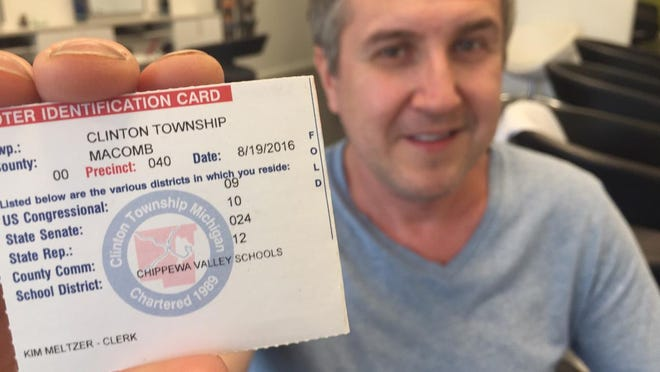 Dmitriy Pomogalov, 44, of Clinton Township emigrated from Belarus in 1992. Two years ago, he became a U.S. citizen. Tuesday, with his 2-year-old son in tow, he will proudly vote for the first time in America. He is the owner of Aria Salon, in Grosse Pointe Woods, where he also is a stylist.