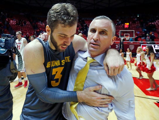 ASU forward Mickey Mitchell and coach Bobby Hurley celebrate Sunday's win at Utah.