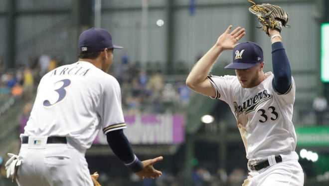 Brewers outfielder Brett Phillips is pumped up after throwing out the Pirates' David Freese in the fourth inning.