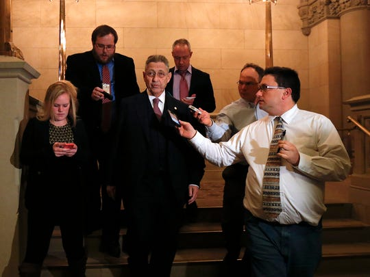 New York Assembly Speaker Sheldon Silver, D-Manhattan, center, talks to reporters in the Capitol on Monday, Feb. 2, 2015, in Albany, N.Y. Silver's 21 years as the leader of the Assembly will come to a close Monday night when he steps down after federal corruption charges.