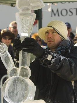 Sculptor Aaron Whitten with one of his works at the 2012 ice festival.