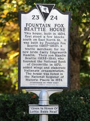 A marker tells the story of the Beattie House, which